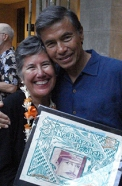 Leilani Holmes shares her award with husband Ivan Holmes, designer of Ancestry of Experience.