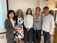 Five people after library talk, including Samuel Yamashita and Roy Yamaguchi, with librarians