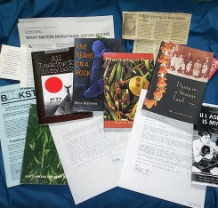 All 5 of Murayama's books, surrounded by clippings and letters