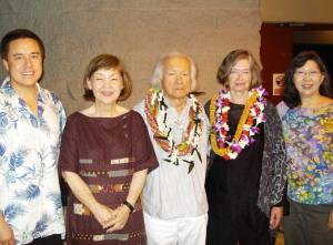5 people, including Murayama and wife Dawn, wearing lei.